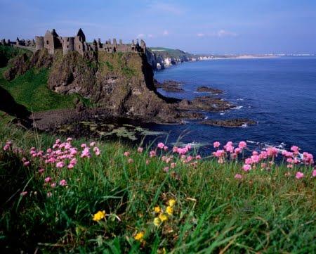 A castle on the Irish coast, above a cliff.